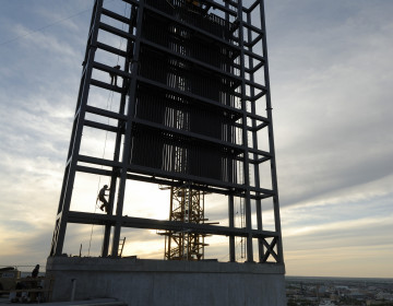 The last piece of steel goes up on the Manitoba Hydro Building's solar chimney.